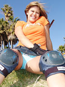 Cute Teen Topanga plays around on her roller blades